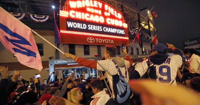 Cubs return to Chicago hours after winning World Series