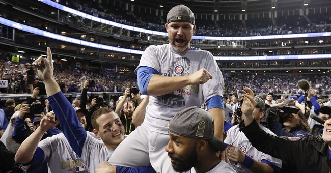 Column: With help from above, Cubs finally win a title