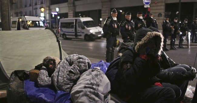 After Calais, French authorities clear migrant camp in Paris