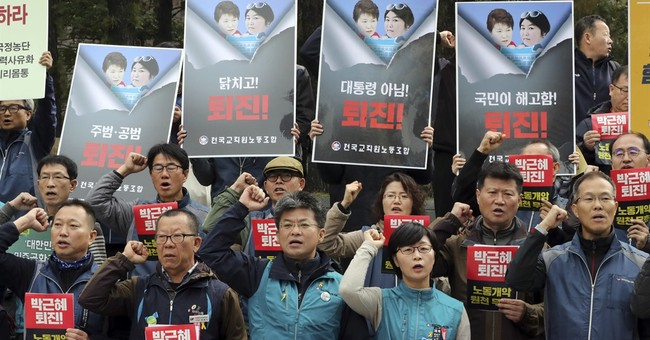 The Latest: S. Korea prosecutors OK arrest of Park's aides