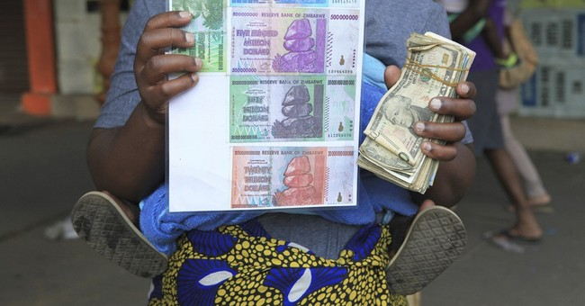 As Zimbabwe tries new currency, skeptics reach for the old