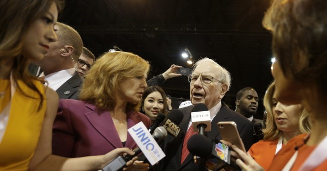 Buffett's firm's 3Q profit drops 24 pct on investments value