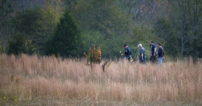 Body found on land where woman was chained up 'like a dog'