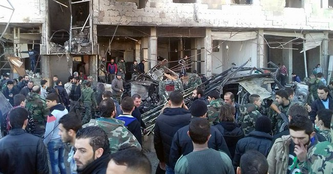Dozens killed by bombs in Syria, clouding UN peace session
