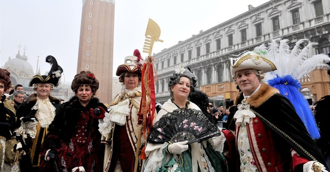 Police ask Venice carnival-goers to lift masks for security