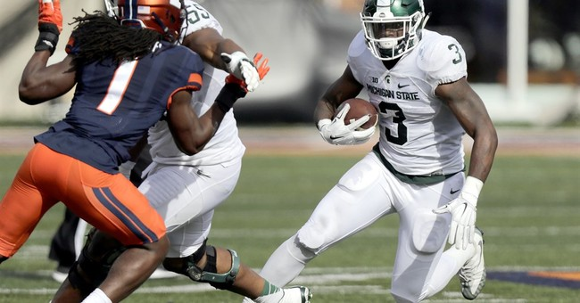 George leads Illinois to 31-27 win over Michigan State