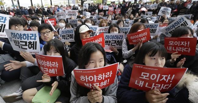 2 former aides of Park arrested as S. Korea scandal widens