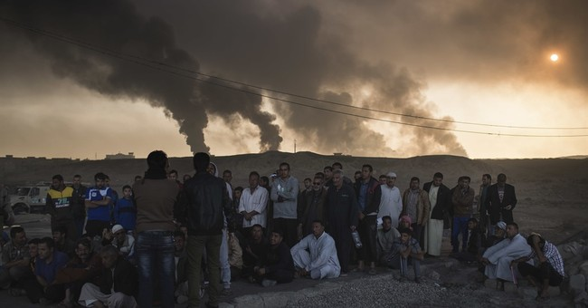 The Latest: IS claims 2 deadly bombings north of Baghdad