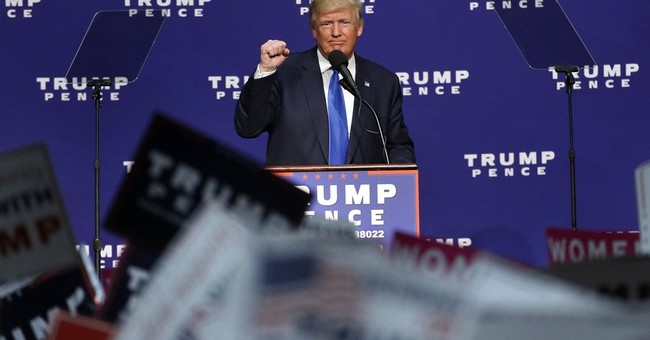 The Latest: Trump raps McAuliffe for restoring voting rights