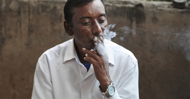 With mixed progress, nations review war vs. tobacco industry