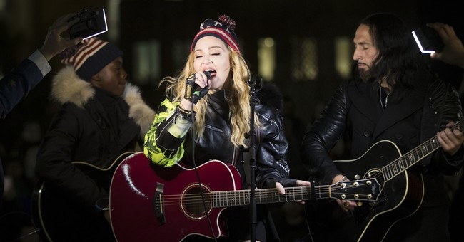 Madonna plays surprise concert in park for Hillary Clinton