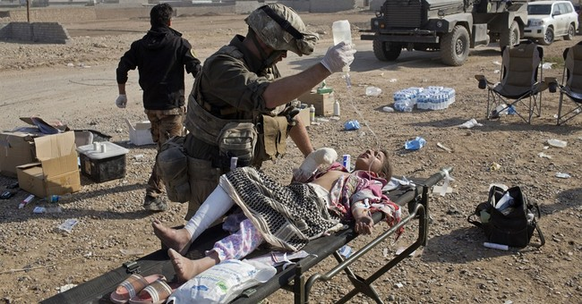American volunteer medics treat casualties of Mosul combat
