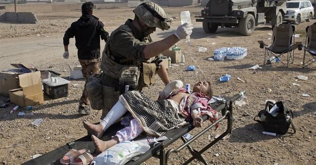 American volunteer medics treat casualties of Mosul combat