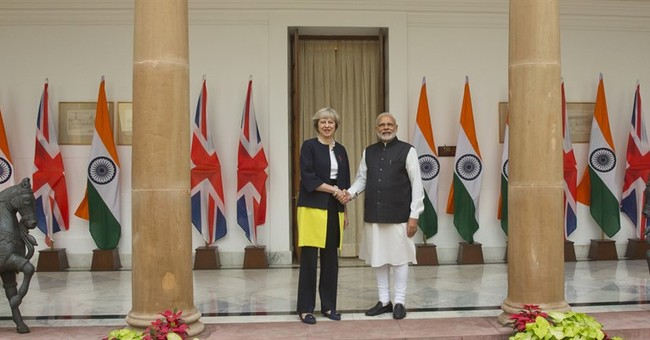 India, Britain talk trade and investment during May's visit