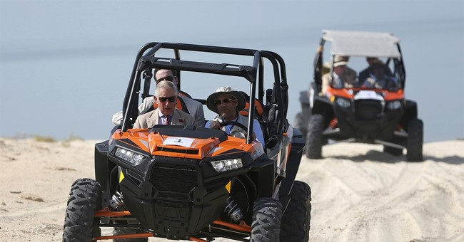 Prince Charles sees remote UAE island by dune buggy, boat