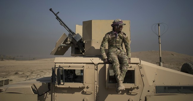 Iraqi Kurdish forces advance as mass grave found near Mosul