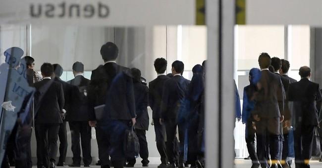 Japan authorities raid Dentsu in overwork suicide case