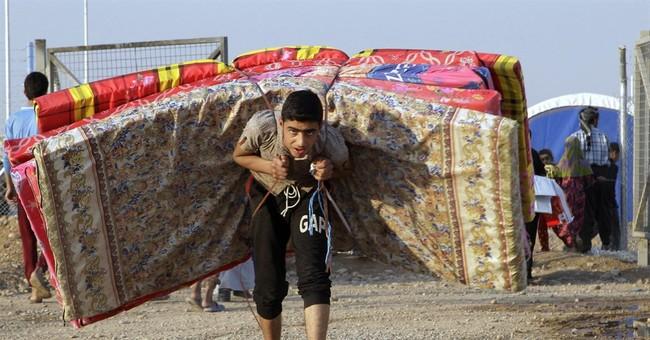 Mosul Today: Iraqis probe mass grave near IS-held Mosul
