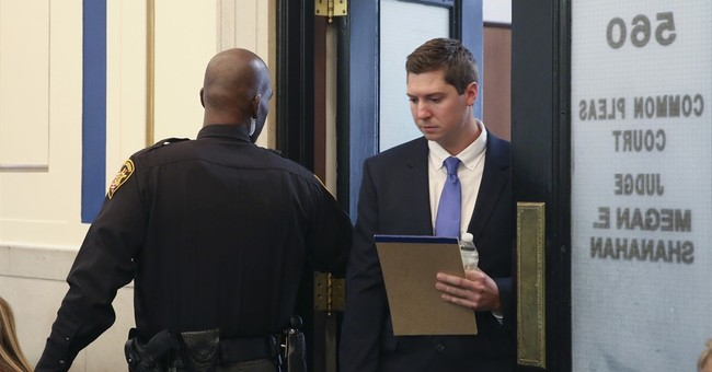 Ex-cop thought of black driver: 'He's going to run me over'