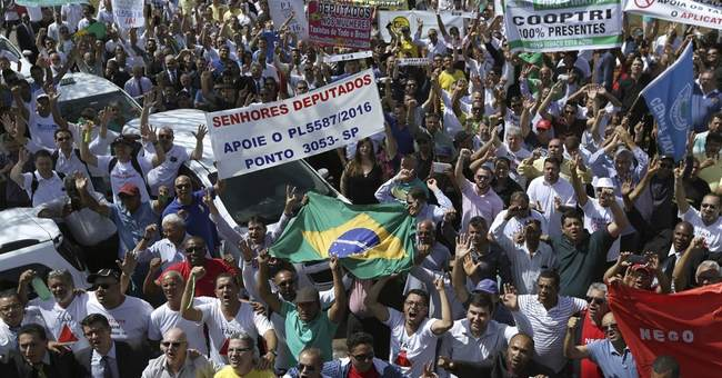 Taxi drivers protest against Uber in Brazil's capital