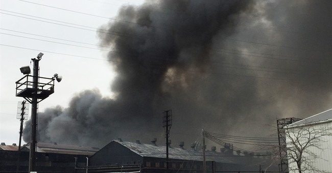 Official: Hot bulb hitting cardboard sparked massive NY fire