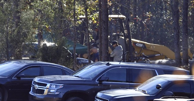The Latest: Coroner to identify 2 bodies found on property