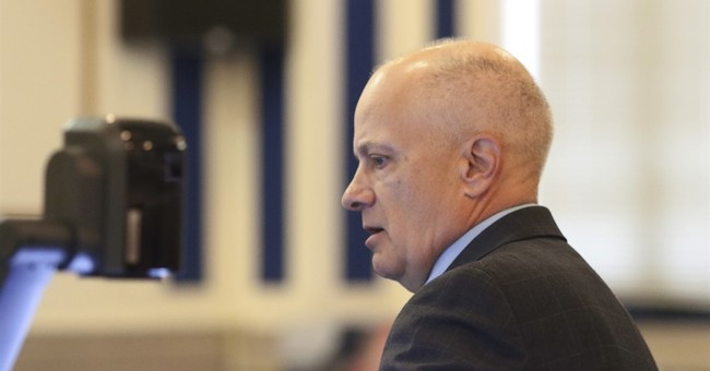 The Latest: Schools close, city on alert as jury deliberates