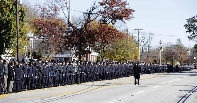Thousands of officers line streets for slain NYC sergeant
