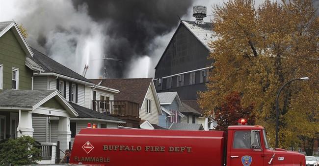 Demolition begins as fire burns at ex-steel mill site