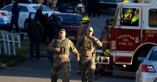 The Latest: Suspect in shooting of 2 officers found dead