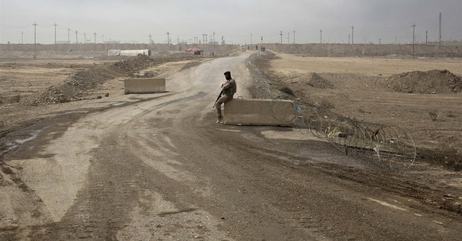 Iraq troops slow Mosul advance as they clear neighborhoods