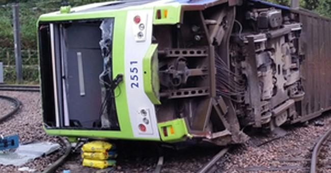 UK police bail driver in tram derailment that killed 7
