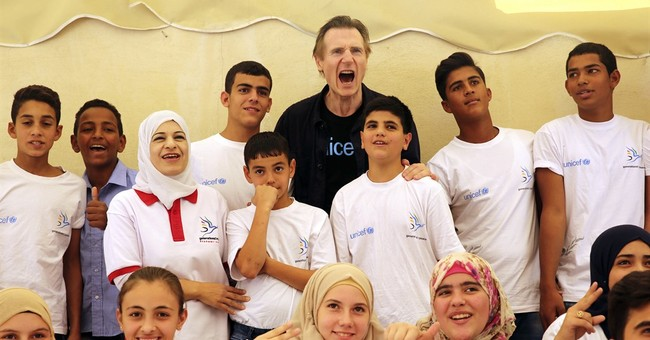 Syrian teens tell UNICEF envoy Liam Neeson about tough exile