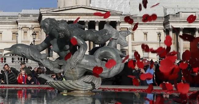 French president, Britain's Prince Harry mark Armistice Day