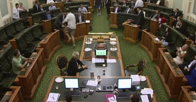 Shoeless, shirtless, breathless, Aussie lawmakers still vote