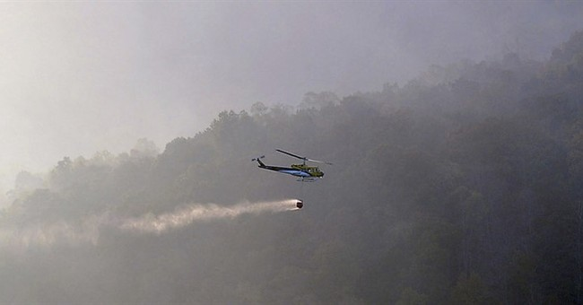 Southerners wearing masks as smoke streams from mountains