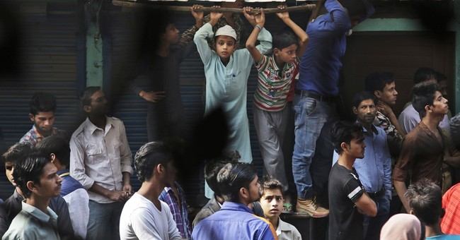 At least 13 workers die in garment factory fire in India