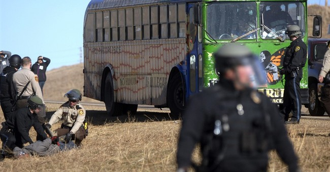 The Latest: Road reopens after pipeline protesters blockade