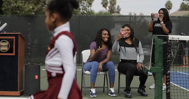 Straight back to Compton: Venus and Serena Williams go home