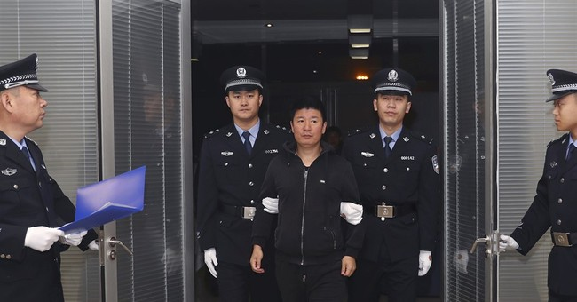 China says fugitive businessman returns after 15 years