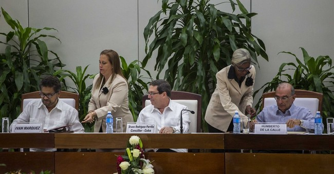 Colombia tries again for peace with sides signing new accord