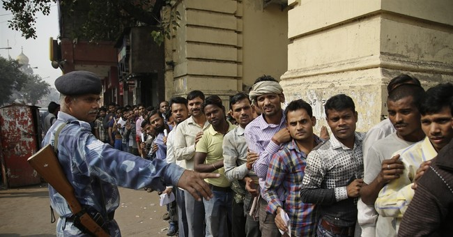 Chaos as millions in India crowd banks to exchange currency