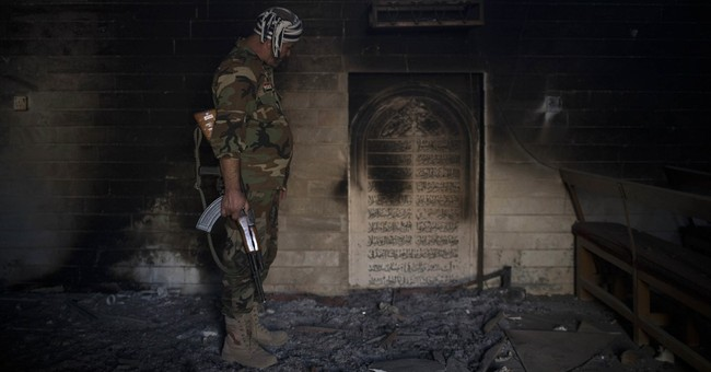 The Latest: Iraqi forces drive IS from Nimrud