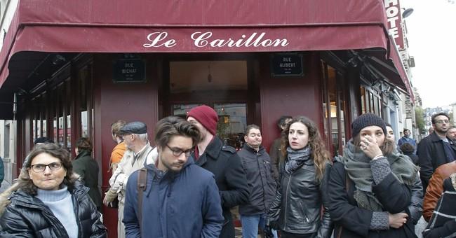 The Latest: Floating lanterns mark Paris attack anniversary
