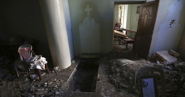 Gasps, tears as Iraqis return to IS-destroyed parish