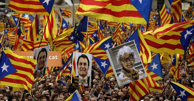 Catalans protest Spain's legal challenges to secession