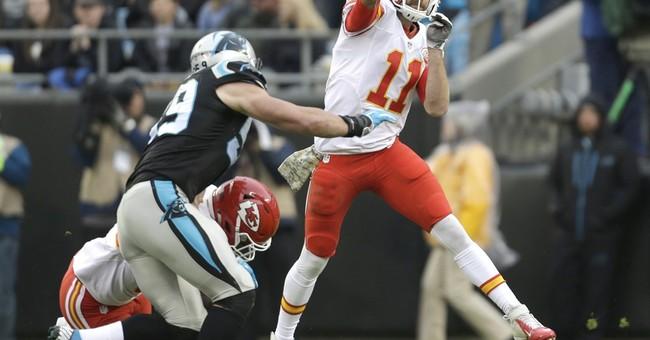 Chiefs quarterback Alex Smith wears safety pin for unity