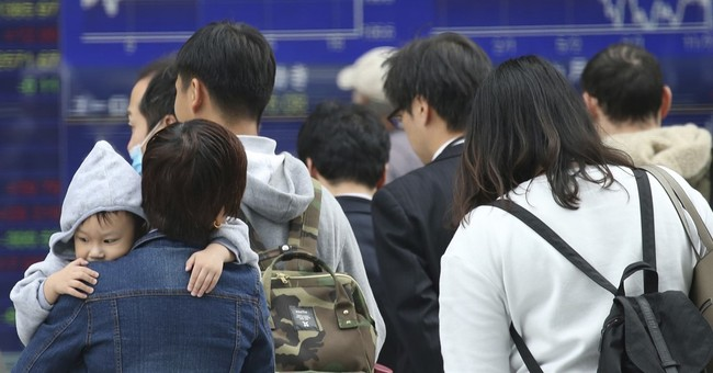 Asian shares mostly lower, Nikkei gets boost from weak yen