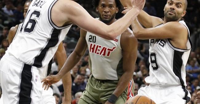 Leonard has 24 points, Spurs hold off Heat, 94-90