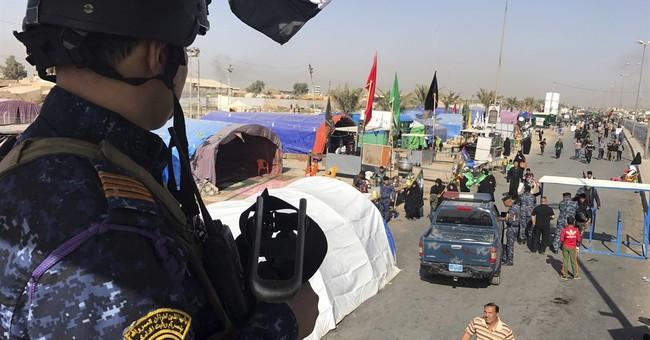 Suicide bombers kill 12 in Iraqi cities of Fallujah, Karbala
